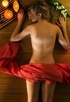 cute woman relaxing herself in a spa with a warm light around